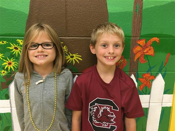 State Fair Art Show Winners Division 3-D in The Art of the Camellia Exhibit-1st Place Cole Neeley  & 2nd Place Leila Ortiz