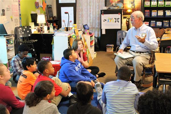 """Real Men Read"" at Leaphart Elementary highlights importance of reading, male role models"