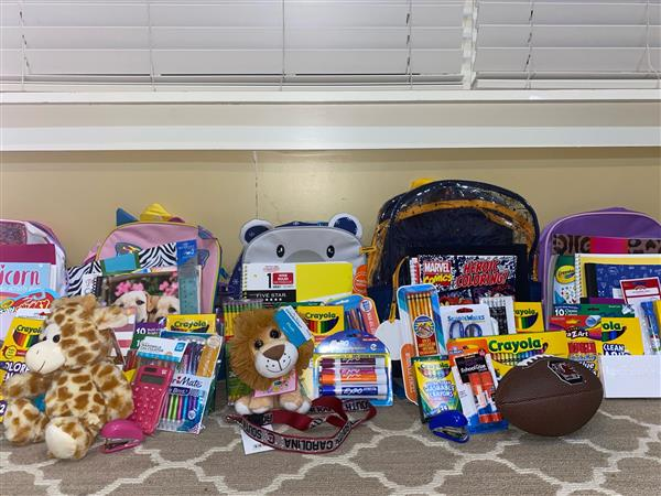 School District Five elementary school receives backpacks filled with supplies from USC sorority