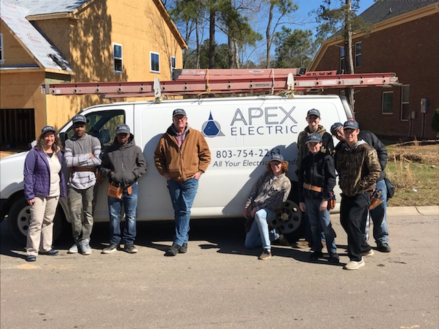 School District Five students help install wiring at a new home during field study