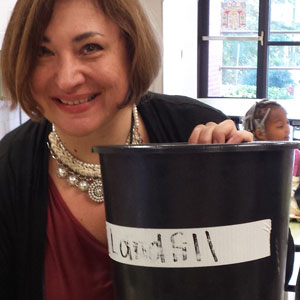 Teacher with Landfill Bucket