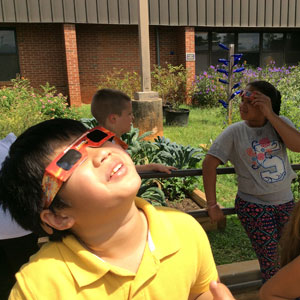 Student using solar glasses to look at the sun