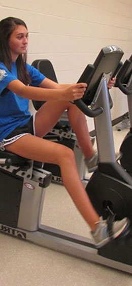 Student on an elliptical bike
