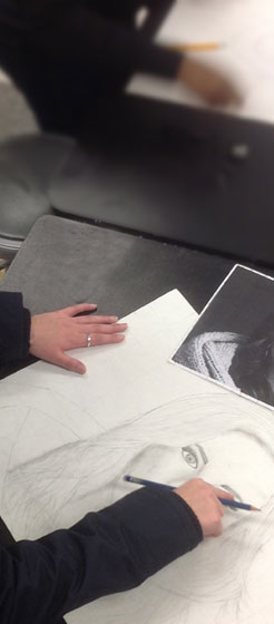 Student drawing in a visual arts class