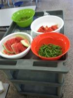 bowls of watermelon and green beans from the garden
